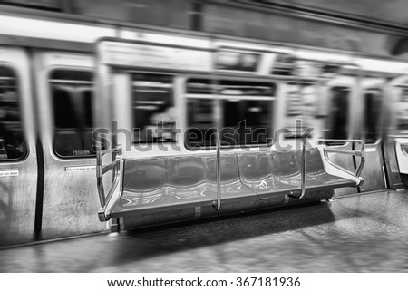 Fast moving subway. Interior view.