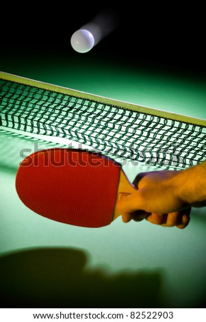 Fast moving table-tennis ball over the net - stock photo