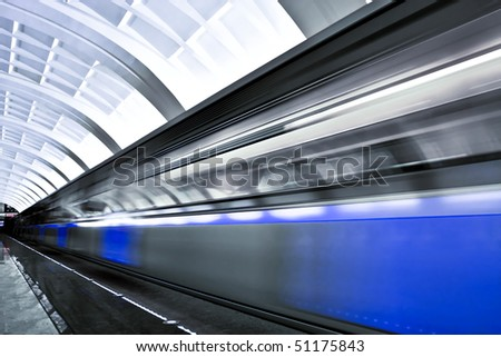 fast moving train by motion - stock photo