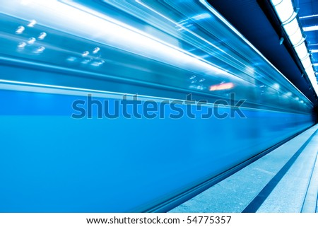 fast moving train in motion - stock photo