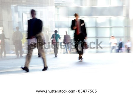 Fast Paced Business World with Blurred Motion. People walking. All exposed faces are motion blurred.