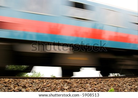 Fast passenger train passing by with motion blur - stock photo