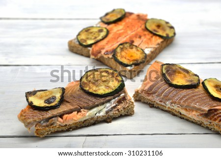 Fast quality food: toast salmon with zucchini - stock photo