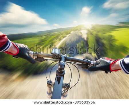 Fast ride on mountain rocks. Sport and active life concept - stock photo