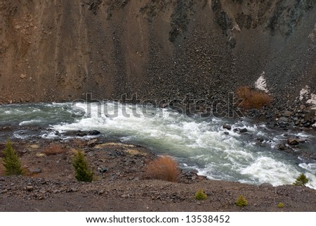 Fast running river in a canyon in the spring