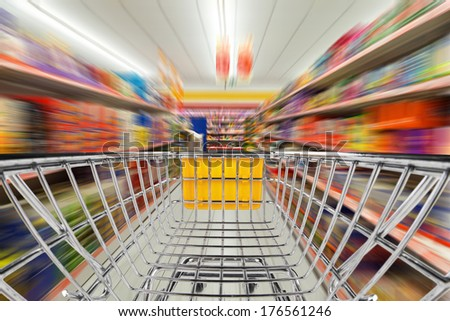 fast shopping cart in supermarket - stock photo
