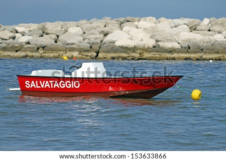 fast speedboat rescue service moored in the sea in summer - stock photo