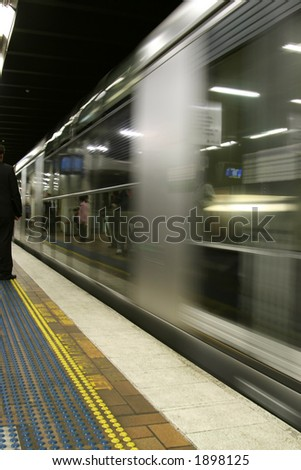 fast subway entering the station - stock photo