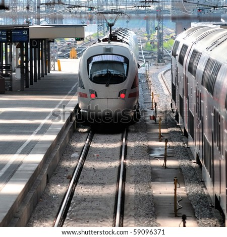 Fast train arriving/departing in train station - stock photo