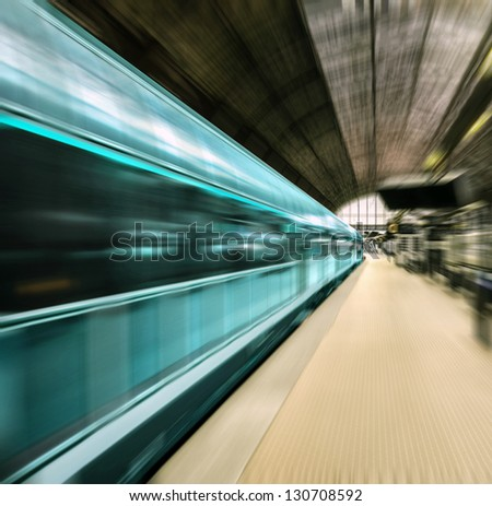Fast train in motion blur - stock photo