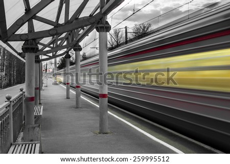 Fast train leaving  from the empty train station, black and white - stock photo