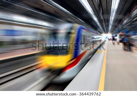 Fast train leaving station - stock photo