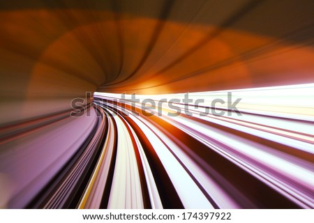 Fast train passing in tunnel - stock photo
