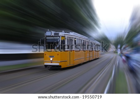 Fast tram with motion blur - stock photo