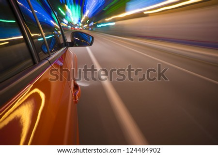 Fast vehicle moving on Motion blur background. - stock photo