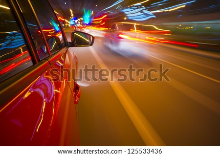 Fast vehicle moving on Motion blur background - stock photo