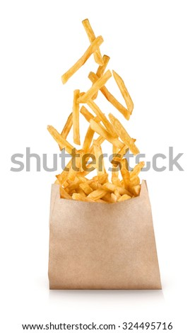 Fastfood. French fries. Flying fried potatoes on white background. - stock photo
