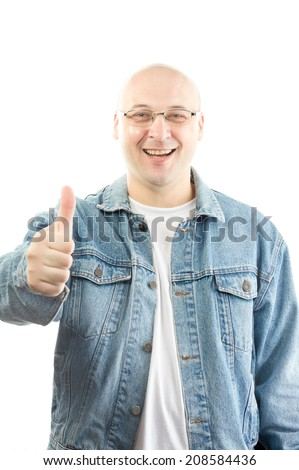 fat bald man wearing jeans jacket makes thumb up  - stock photo