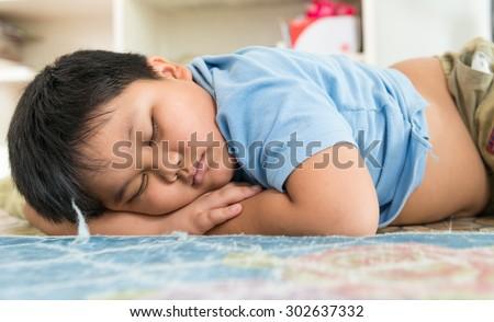 Fat boy sleep dream on his arm. - stock photo