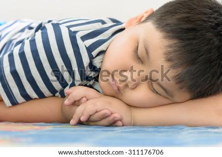 fat boy sweet dream on his arm - stock photo