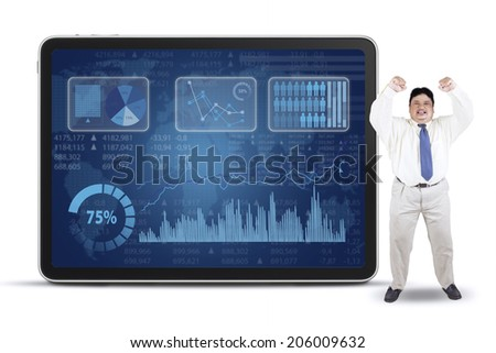 Fat businessman celebrate his success while standing near to financial graph - stock photo