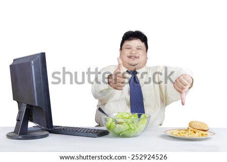 Fat businessman showing hand gesture for showing good food and bad food - stock photo