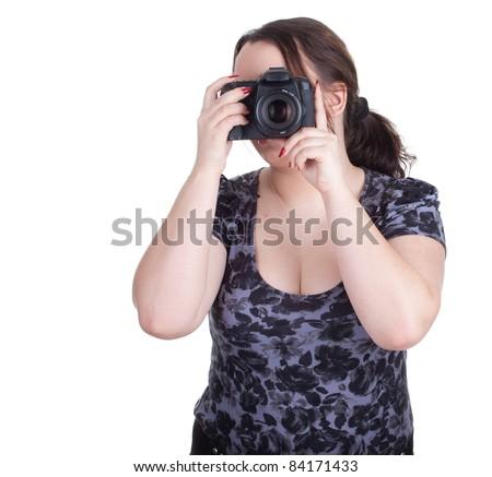 fat female photographer with professional digital camera - stock photo