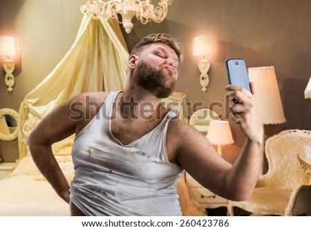 Fat glamour man takes selfie - stock photo