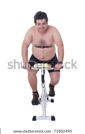 Fat man doing workout in static bicycle - stock photo
