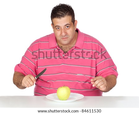 Fat man eating a apple isolated on white background - stock photo