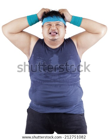 Fat man expressing stressful after failed for dieting - stock photo