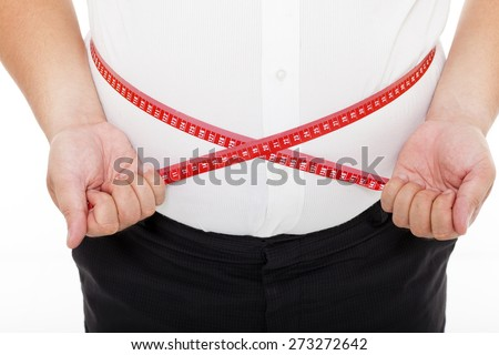 Fat man holding a measurement tape - stock photo