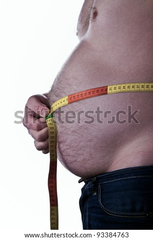 fat man holding a measurement tape around his belly - stock photo