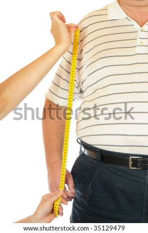 Fat man is beeing measured - stock photo