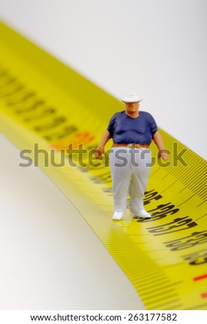 fat man looking and  measurer - obesity concept - stock photo
