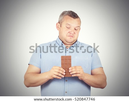 fat man refuses to chocolate. Diet, overweight, healthy food isolated on background.