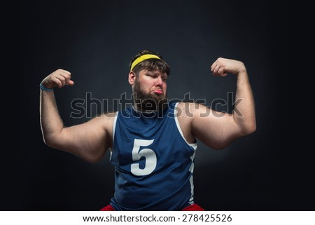 Fat man shows his muscle - stock photo