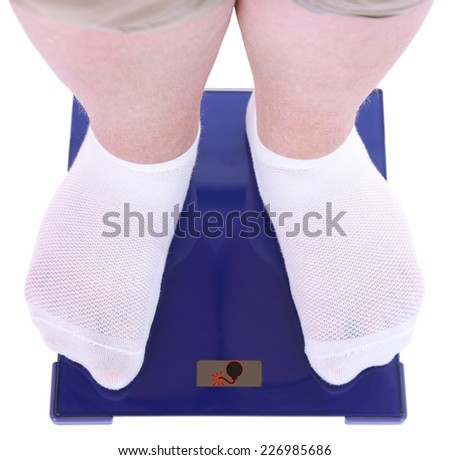 Fat man standing on electronic scales. Conceptual photo of weight loss. - stock photo