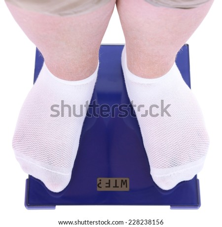 Fat man standing on electronic scales isolated on white. Conceptual photo of weight loss. - stock photo
