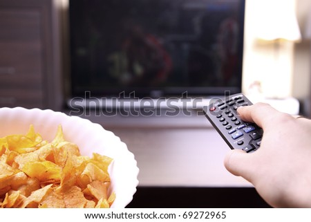 fat man watching TV - stock photo