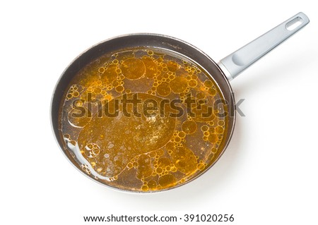Fat spots on a frying pan - stock photo