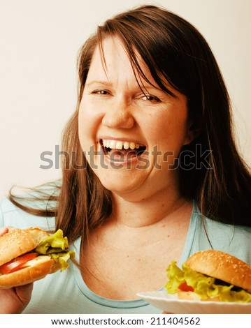fat white woman having choice between hamburger and salad isolated - stock photo