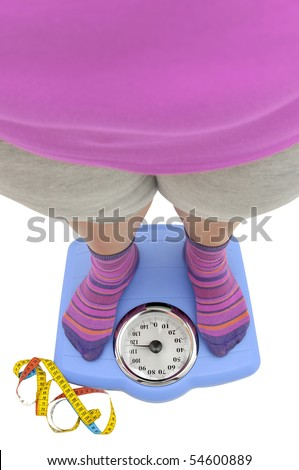 Fat woman body part in a scale with measuring tape - stock photo