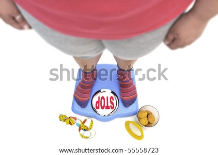 Fat woman body part in a scale with the word stop, and a jar of cookies - stock photo