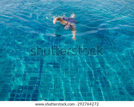 fat woman swimming pool