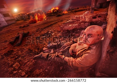 Fat zombie with the gun on the ruined city background. - stock photo