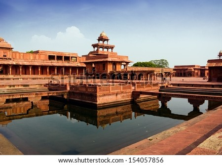 Fatehpur Sikri mirrored in a water pool in India - stock photo