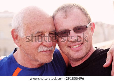 father and  adult son  - stock photo