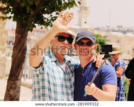 father and  adult son spending time together - stock photo