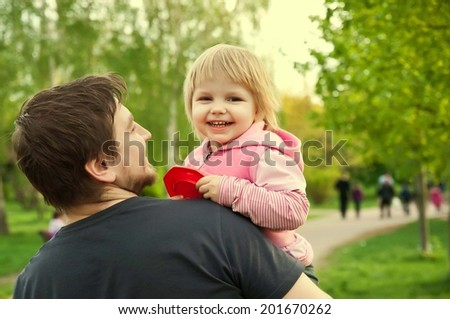 father and baby laughing